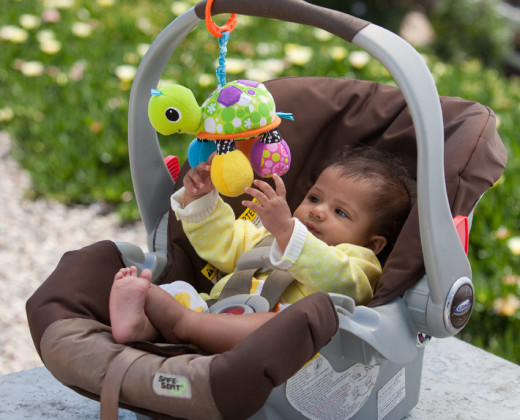 Attach it to a car seat or layette.  Photo by Infantino.