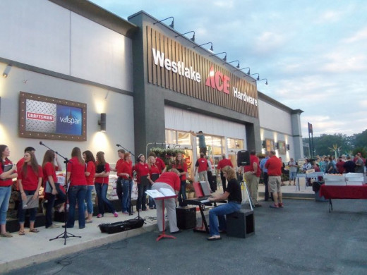 Grand Opening of an Ace Hardware Store.  Hundreds waiting in line were served coffee and donuts, hoping to be the first 200 to receive a prize.