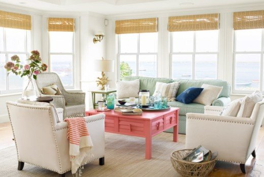 Coral coffee table pops and brings your eye to the center of the room.