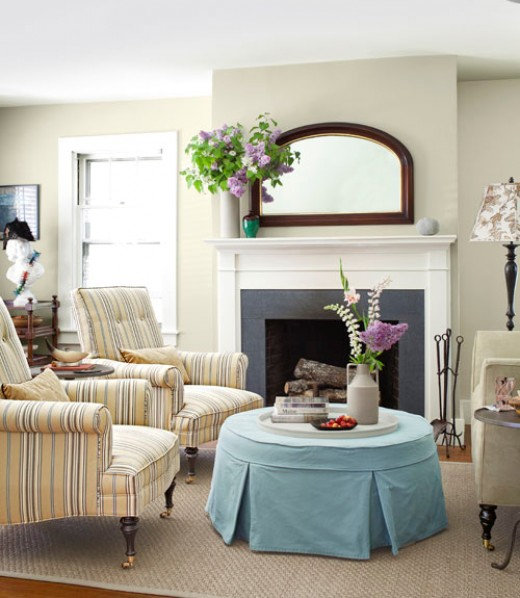 A cottage setting takes advantage of the pastel blues, stripes and large mirror in keeping with this year's trend.