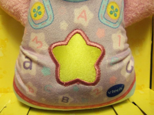 Push the bright glowing yellow star for the bear to play or stop playing.