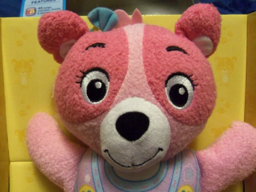 Comes in pink or blue.  You can see the fleece like texture of the toy making it a comfortable item to hold and sleep with.