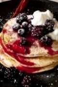 Blueberry pancakes with ice cream, raspberries and whipped topping.Photos by google images