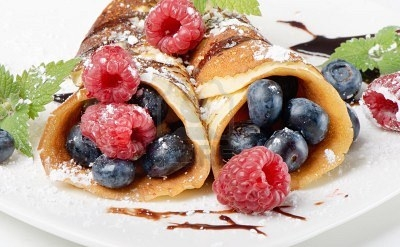 Blueberry crapes with raspberries.