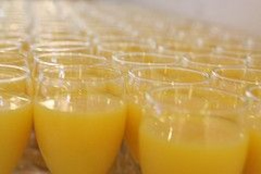 Small Glasses of Orange Juice