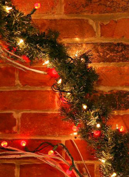 Christmas Garland on the Wall by Cliff