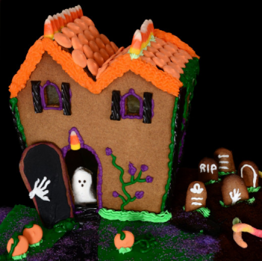 Here is a Halloween cake made out of gingerbread.   Looks like a Witch House to me!