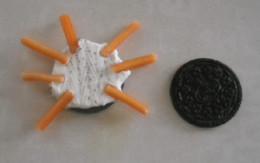 Making Spider Legs On Oreo Cookies