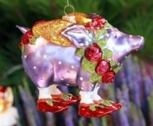 A Beautiful Glass Ornament Called Violetta Pig By Patience Brewster.  Image from Amazon and you can buy this collectible Christmas ornament here.