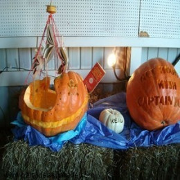 This pumpkin has been carved into a pirate's ship and the sails are made from soft cover paperback books.