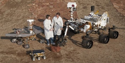 Here's a picture of 3 different generations the Mars Rover.  You can also see two of the space, along with a couple of the Nasa spacecraft engineers from Jet Propulsion Laboratories in California.  Photo Credit:  Public Domain - NASA Rover Pictures