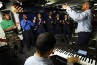 Photo of the US Navy Praise Gospel Choir practicing aboard the aircraft carrier USS John C. Stenn.