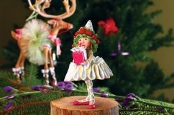 Dancer's Elf Is The Gift Elf.  She is ready to dance the nigh away in her toe shoes.  Picture Credit Amazon
