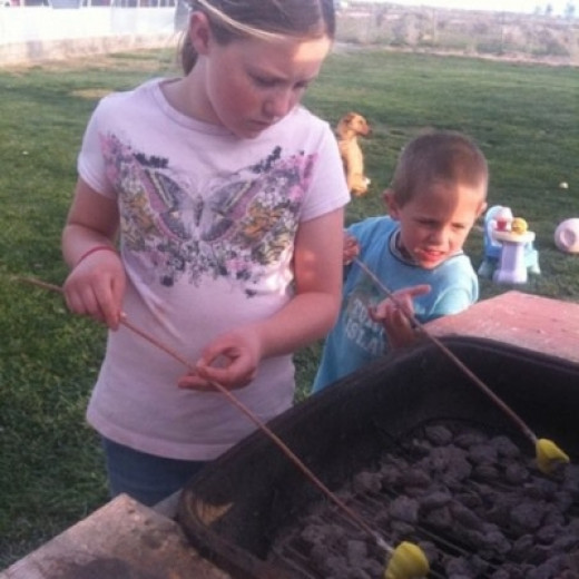 Big Kids Help Little Kids with their S'Mores
