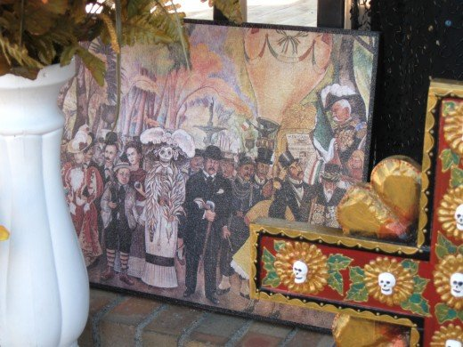 Painting of family and deceased ancestors celebrating El Día de los Muertos