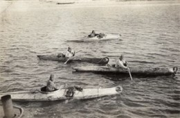 Alaska Natives kayaking.