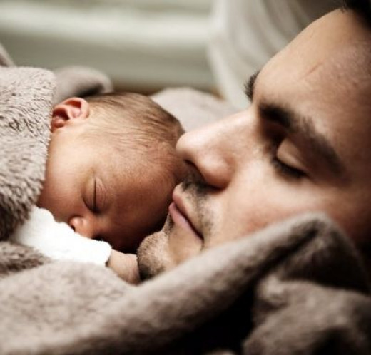 Dad's Pride Shines in Taking Care of Baby