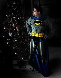 This could be you on Christmas morning this year. Standing next to the tree, ready to take on the vices of the world. Remember, the Batman Snuggie is three things: Freedom, Warmth, Security. It's a security blanket with sleeves.