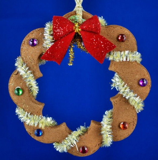 Two sizes of similarly shaped cookie cutters were used to make an open wreath shape.
