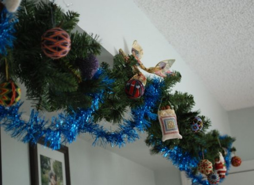 This year, we've added a new pine garland we acquired, which now has all our temari ornaments on it.  Other decorations have been added to some tinsel garlands we've put up, and any place else we can come up with!