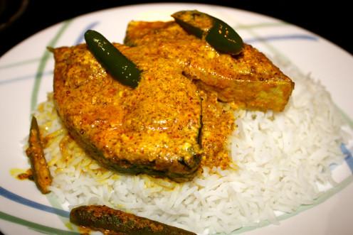 Steamed Hilsa in Mustard Sauce in a bed of cooked Basmati rice