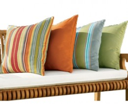 Bench cushions with pillows are a great way to add a splash of color to your patio furniture.
