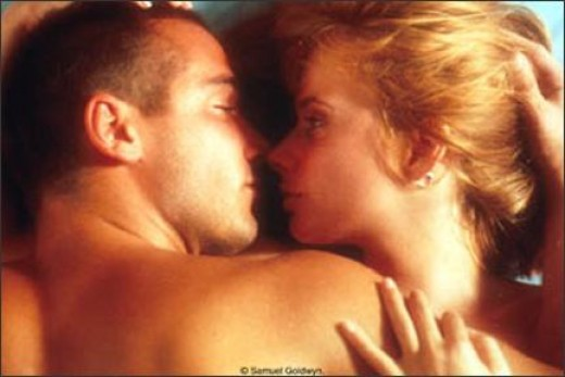 Jean Marc-Barr and Rosanna Arquette as Johana.