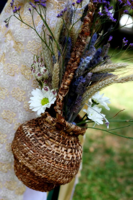 Flower basket I wove to carry my bouquet after a basic coiled basket weaving lesson from one of my bridesmaids