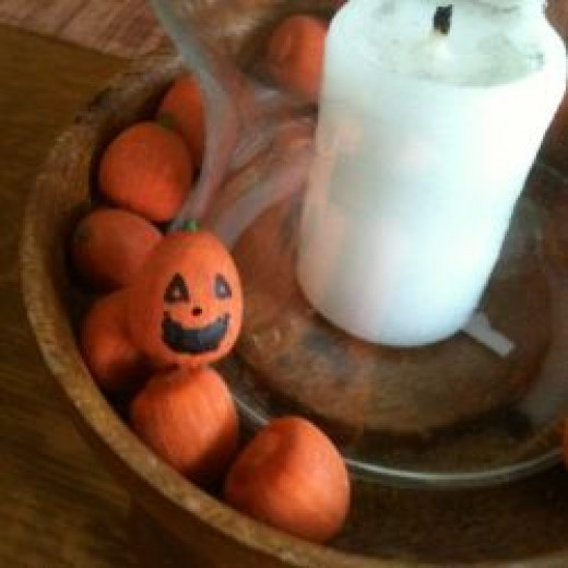 Yes, I painted every one of these acorns to look like pumpkins. I even put a jackolantern face on one!