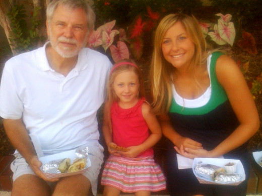 I usually meet one of my daughters here! This is my husband, my grand-daughter and my youngest daughter.