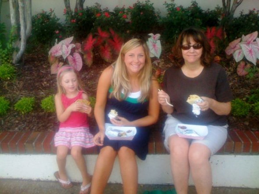 Find a seat and eat! Note that the youngest lady is eating a cookie. Picture of Babycakes, Melly, and me.
