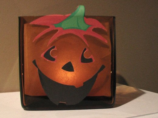 This was an easy (http://crafting.squidoo.com/very-easy-jackolantern-candle-craft-project) decoupage project I made one Halloween.