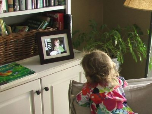 My Grand-daughter watching the Show on the Digital Photo Frame